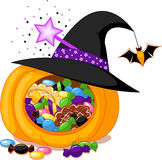 Halloween pumpkin. With witch hat and sweets Stock Photos