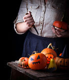 Halloween pumpkin and woman hands with knife Royalty Free Stock Images