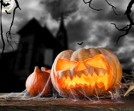 Halloween pumpkin on wood with dark background Stock Photos