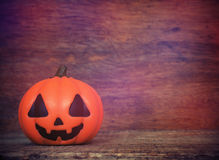 Halloween pumpkin on wooden background Royalty Free Stock Photos