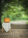 Halloween pumpkin on wooden floor in the house and nature forest Royalty Free Stock Photography