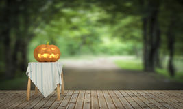 Halloween pumpkin on wooden floor in the house and nature forest Stock Image