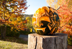Halloween pumpkin on a wooden stump outside Stock Image