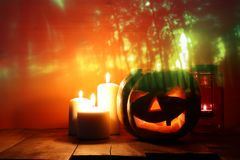 Halloween Pumpkin on wooden table in front of spooky dark background. Jack o lantern Royalty Free Stock Photo