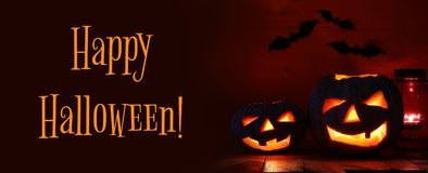 Halloween Pumpkin on wooden table in front of spooky dark background. Jack o lantern Royalty Free Stock Photography