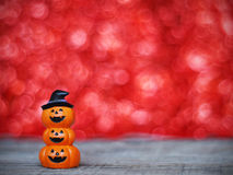 Halloween pumpkin on wooden table over red bokeh backgroun Stock Images