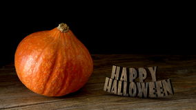 Halloween Pumpkin on wooden table. And text 3D stock footage