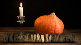 Halloween Pumpkin on wooden table. And text 3D stock video footage