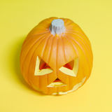 Halloween Pumpkin on yellow. Background (square composition Stock Photography