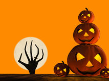 Halloween pumpkin and zombie hand rising Royalty Free Stock Photography