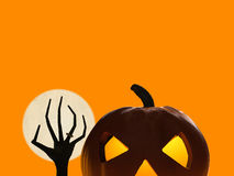 Halloween pumpkin and zombie hand rising Royalty Free Stock Images