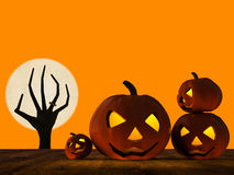 Halloween pumpkin and zombie hand rising Stock Photos