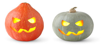 Halloween pumpkins. Isolated pumpkins. Two halloween pumpkin heads of different color with glowing eyes isolated on white background Royalty Free Stock Image
