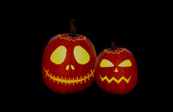 Halloween pumpkins. Two carved pumpkins on black background Royalty Free Stock Photos