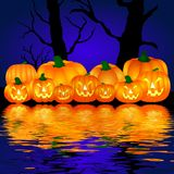 Halloween pumpkins. Illustration of a group of carved Halloween pumpkins reflecting in the water at night Stock Photos