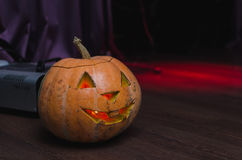 Halloween pumpkins background. Scary glowing faces trick or treat Stock Photography