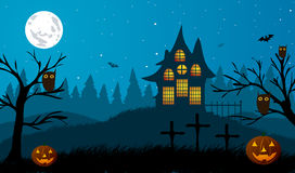 Halloween. Pumpkins on a background of trees, crosses, old house and trees. Stock Photo