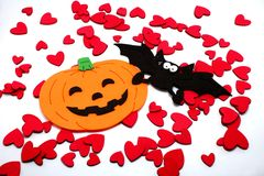 Halloween Pumpkins and bat with small hearts Royalty Free Stock Images