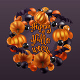 Halloween pumpkins, bats and decoration wreath. Royalty Free Stock Photos