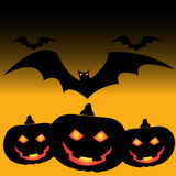 Halloween pumpkins and bats vector Royalty Free Stock Photos
