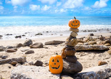 Halloween pumpkins on the beach Royalty Free Stock Image