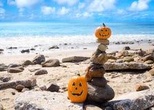 Halloween pumpkins on the beach Royalty Free Stock Image