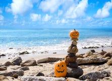 Halloween pumpkins on the beach stock photography