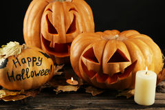 Halloween pumpkins on brown wooden background. Royalty Free Stock Photo
