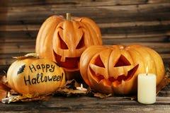 Halloween pumpkins on brown wooden background. Stock Photo