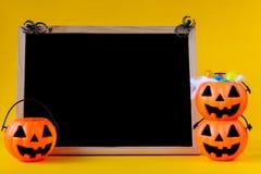 Halloween pumpkins bucket with chalkboard royalty free stock images