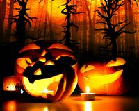 Halloween pumpkins with candle flames Royalty Free Stock Images
