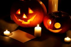 Halloween pumpkins with candles and card Stock Photography