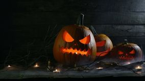 Halloween pumpkins and candles stock video