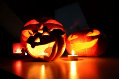 Halloween pumpkins and candles Stock Photos