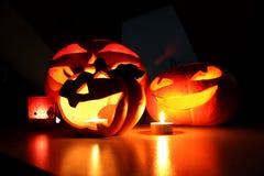 Halloween pumpkins and candles Stock Photos