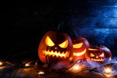 Halloween pumpkins and candles royalty free stock image