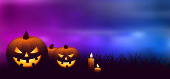 Halloween pumpkins with candles in a spooky forest at night. Royalty Free Stock Photography
