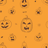 Halloween pumpkins with carved pumpkins. Vector seamless pattern with carved Halloween pumpkins, black and orange Halloween wrapping paper Stock Photos