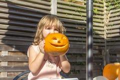 Halloween pumpkins carving in the garden Stock Images