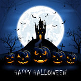Halloween pumpkins and castle on blue night background Royalty Free Stock Photography