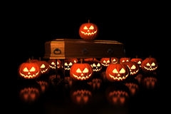 Halloween Pumpkins on the coffin Royalty Free Stock Images