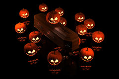 Halloween Pumpkins on the coffin Stock Images