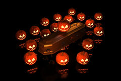 Halloween Pumpkins on the coffin Royalty Free Stock Photos
