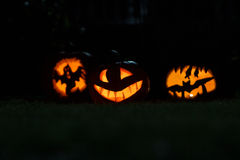 3 Halloween pumpkins. With dark background Royalty Free Stock Photo