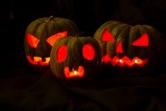 Halloween pumpkins in the dark Stock Photos