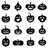 Halloween pumpkins different form with scary faces Stock Photos