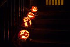 Halloween pumpkins on door steps Stock Photo