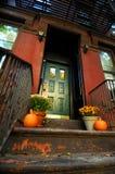 Halloween Pumpkins by doorway royalty free stock images