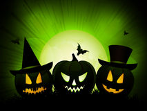 Halloween pumpkins on an eery green background Stock Photo