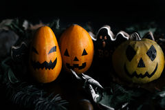 Halloween pumpkins with eyes and mouth. Black background, close up studio shootWoman holds in her hands halloween pumpkin on the d Royalty Free Stock Images